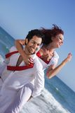 Young couple enjoying on the beach Stock Photo