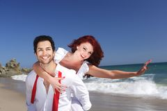Young couple enjoying on the beach Stock Images