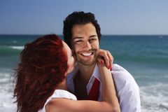 Young couple enjoying on the beach flirting Stock Image