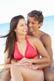 Young Couple Enjoying Beach Holiday. Smiling Royalty Free Stock Photos