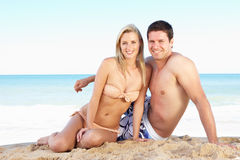 Young Couple Enjoying Beach Holiday Stock Images