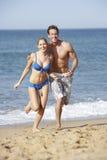Young Couple Enjoying Beach Holiday Stock Photo