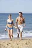 Young Couple Enjoying Beach Holiday Royalty Free Stock Photos