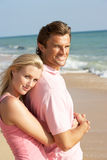 Young Couple Enjoying Beach Holiday In The Sun Royalty Free Stock Photo