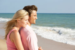 Young Couple Enjoying Beach Holiday In The Sun stock image