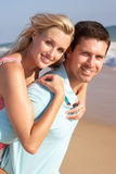 Young Couple Enjoying Beach Holiday In The Sun Royalty Free Stock Photos