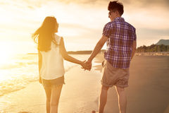 Young couple enjoying a beach walk Stock Images