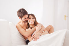 Young couple enjoying in bed Royalty Free Stock Images