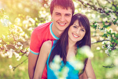 Young couple enjoying in blooming garden Stock Image
