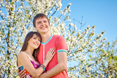 Young couple enjoying in blooming garden Stock Photography