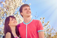 Young couple enjoying in blooming garden Royalty Free Stock Image