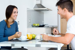 Young Couple Enjoying Breakfast in the kitchen Royalty Free Stock Images