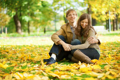 Young couple enjoying bright and warm autumn day Stock Photography
