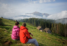 A young couple enjoying in the Carpathian mountains Stock Photos