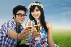 Young couple enjoying champagne outdoor Stock Image