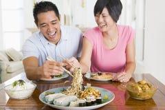 Young Couple Enjoying Chinese Food stock image