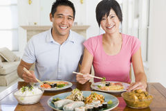 Young Couple Enjoying Chinese Food Stock Images
