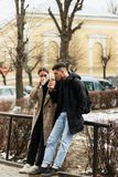 Young couple enjoying coffe outdoor in the city center royalty free stock photography