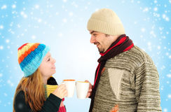 Young couple enjoying a cup of tea Royalty Free Stock Images