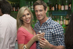 Young Couple Enjoying Drinks In Bar Stock Photography