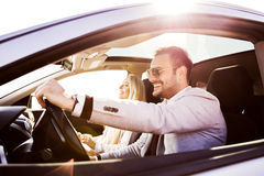 Young couple enjoying the drive Royalty Free Stock Photos