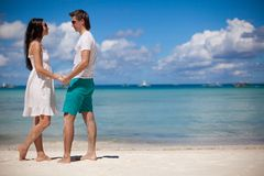 Young couple enjoying each other on a beach Royalty Free Stock Photos
