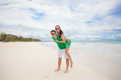 Young couple enjoying each other on a tropical Stock Images