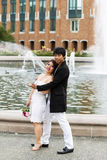 Young Couple Enjoying Each Other at the Water Fountain Royalty Free Stock Photo