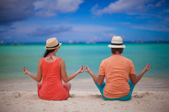 Young couple enjoying each other and yoga on a Stock Images