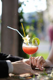 Young couple enjoying exotic drinks Royalty Free Stock Images
