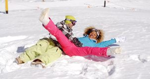 Young couple enjoying a frolic in the snow stock footage