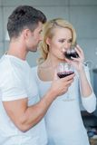 Young couple enjoying a glass of red wine Stock Photography