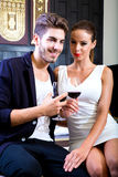 A young couple enjoying a glass of wine in a asian style hotel r Stock Image