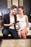 A young couple enjoying a glass of wine in a asian style hotel r Royalty Free Stock Photography