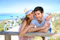 Young couple enjoying holidays in islands. Portrait of sweet couple spending vacation on island Royalty Free Stock Photography