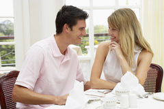 Young Couple Enjoying Hotel Meal Stock Photo