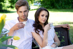 Young couple enjoying lunch in the garden stock photos
