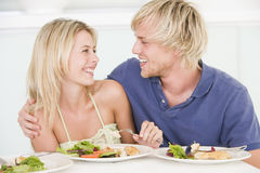 Young Couple Enjoying Meal Royalty Free Stock Image