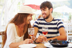 Young Couple Enjoying Meal In Outdoor Restaurant Royalty Free Stock Photography