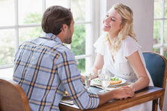 Young couple enjoying a meal together Stock Photo