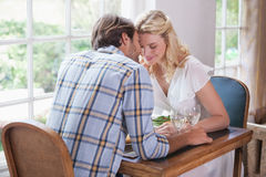 Young couple enjoying a meal together Stock Photography