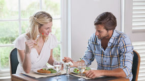 Young couple enjoying a meal together Stock Photos