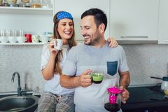 Couple enjoying a morning coffee at home royalty free stock photo