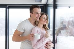 Young couple enjoying morning coffee by the window Stock Photo