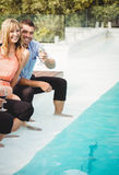 Young couple enjoying near poolside Royalty Free Stock Photography