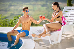 Young couple enjoying next swimming pool Stock Image