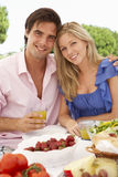 Young Couple Enjoying Outdoor Meal Together Royalty Free Stock Images