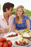 Young Couple Enjoying Outdoor Meal Together Stock Images
