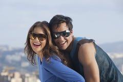 Young couple enjoying outdoors. Close-up of a couple enjoying Royalty Free Stock Image