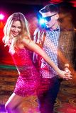 Young couple enjoying party at the club royalty free stock image